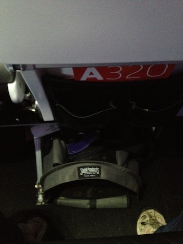 Large SturdiBag (with Chloe inside) in the under-seat space for Seat 14C