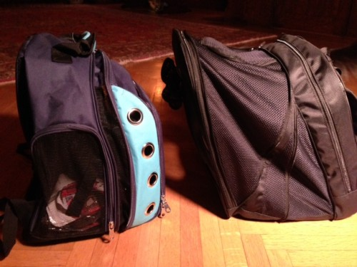 Please note that the pet compartment for the Canine Casual (on the left) includes the area behind the powder-blue, grommeted panel; the pet compartment for the Pet At Work (on the right) ends just to the right of the