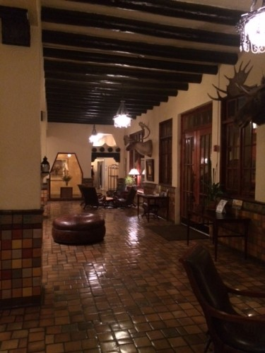 The tiled lobby. Just behind me is a small room with a working fireplace, leading into the dining room.