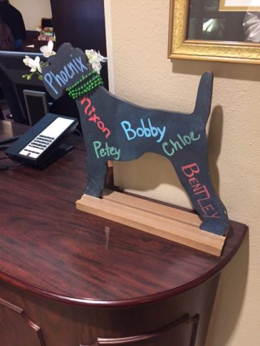 The front desk sign, welcoming visiting pets