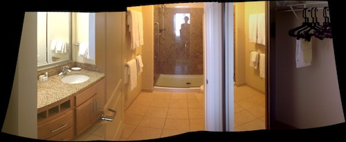 Another panorama: Separate, outside sink at left; bathroom (shower but alas, no tub) in the middle; closet on the right.