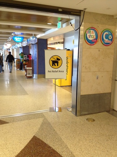 When you're looking at this sign, Gate C2 is to your left, and the pet relief area is down a short hall to the right
