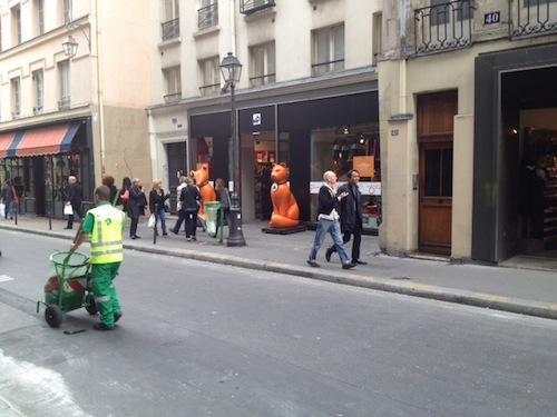 The big orange statues are outside now, perhaps to free up more space inside (the shop is packed with gear and shoppers)