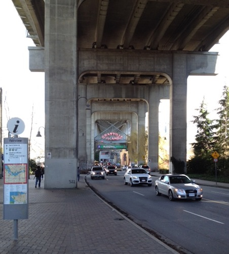 As you're crossing the street, one of those big pillars blocks your view of the Granville Island sign — keep walking forward and you'll see it.