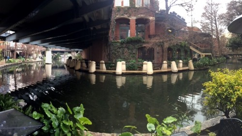 I failed to take a picture of our Drury hotel room in San Antonio, but you can walk directly out of it onto the beautiful Riverwalk, shown here in one of my beloved panoramas — pets welcome to amble alongside you, and Chloe had a blast